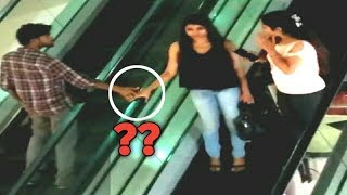 Touching Girls Hand On Escalator    Escalator Prank - PrankBuzz