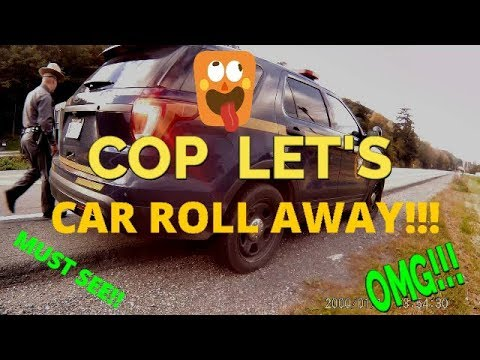COP GETS OWNED AND LETS CAR ROLL AWAY!