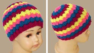 Вязание шапки резинкой. Шапка спицами резинкой.  Knitting cap.