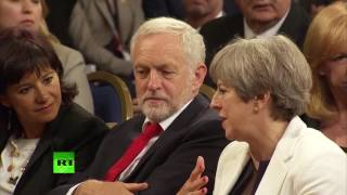 May & Corbyn engage in pleasant exchange before King Felipe VI