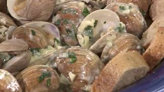 Grilled Clams over garlic butter