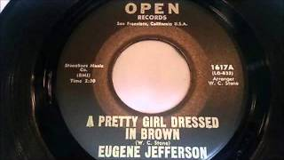 Eugene Jefferson ...  A pretty girl dressed in Brown