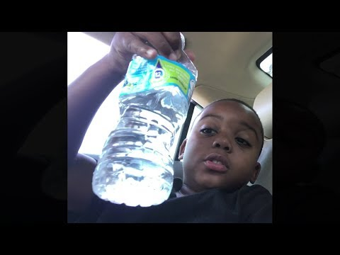 kid drinks bottle of water in 1 second..