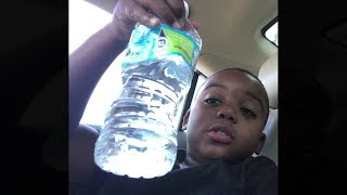 kid drinks bottle of water in 1 second..