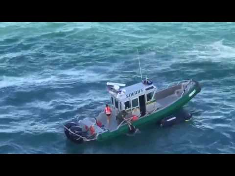 WATCH: Deputy saves jet skiers seconds before cruise ship hits them
