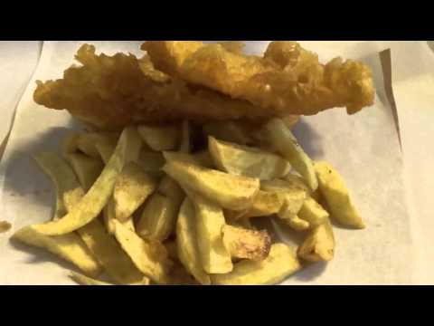 Wrapping Fish And Chips In A Scottish Fish And Chip Shop In Scotland