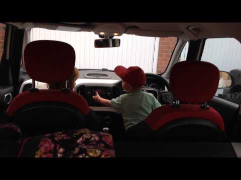 Georgie and Henry dancing in car