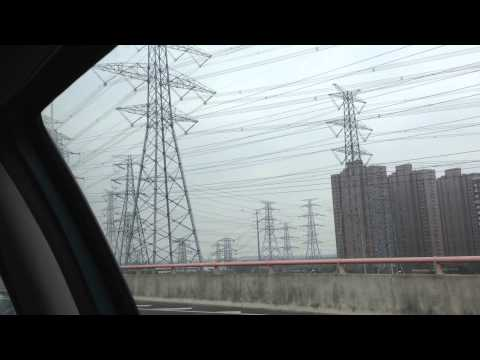 In a taxi on the way to Shanghai Pudong airport
