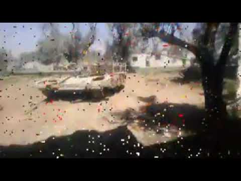 SYRIA:THE LIWA DIR'AL-WATAN BATTLE-TANK IN ACTION TAKING OUT A JIHADIST-STRONGHOLD EAST GHOUTA