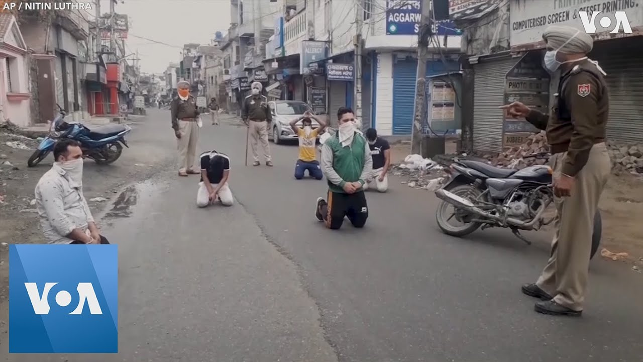 Indian Police Scold Citizens Breaking Coronavirus Curfew - YouTube