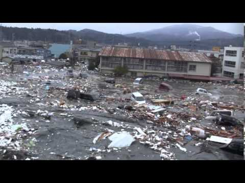 Tsunami in Kesennuma city, ascending the Okawa river