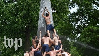 Hundreds of Naval Academy plebes climb monument thumbnail
