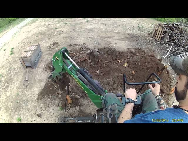 John Deere 2032R and 46 Backhoe digging an old stump. Start to finish.