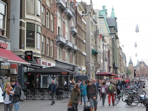 Amsterdam, The Netherlands - strolling Centraal Station to Damrak Avenue shopping area