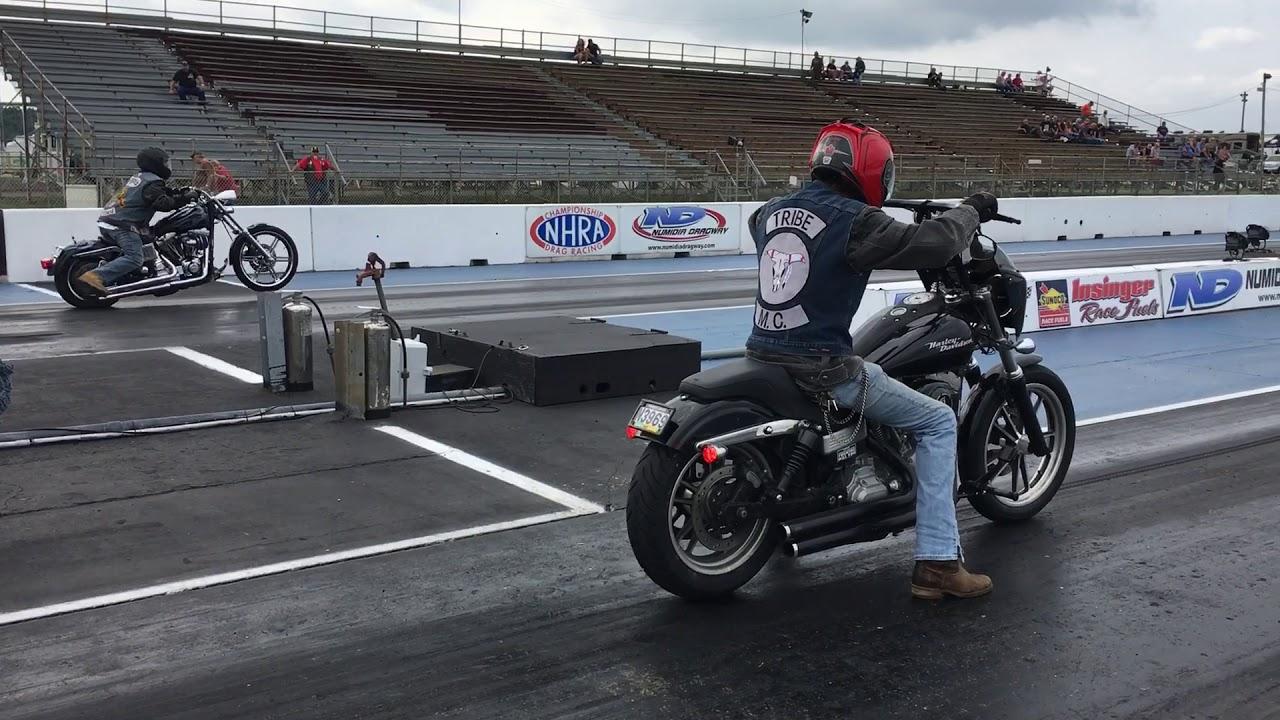 Pagan One-Percenter Wheelies Racing Tribe MC Member At Motorcycle Drag Race