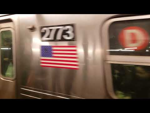MTA R68 Train on the D Line arriving at West Fourth Street–Washington Square station