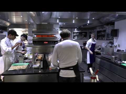 Busy kitchen at the 3 Michelin La Vague d'Or in Saint-Tropez
