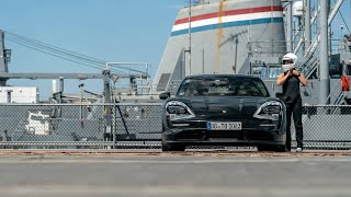 The fully electric Porsche Taycan accelerates 0-90-0 mph on the USS Hornet
