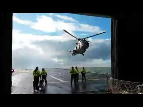 Cougar helicopter landing on HNLMS Rotterdam in stormy weather