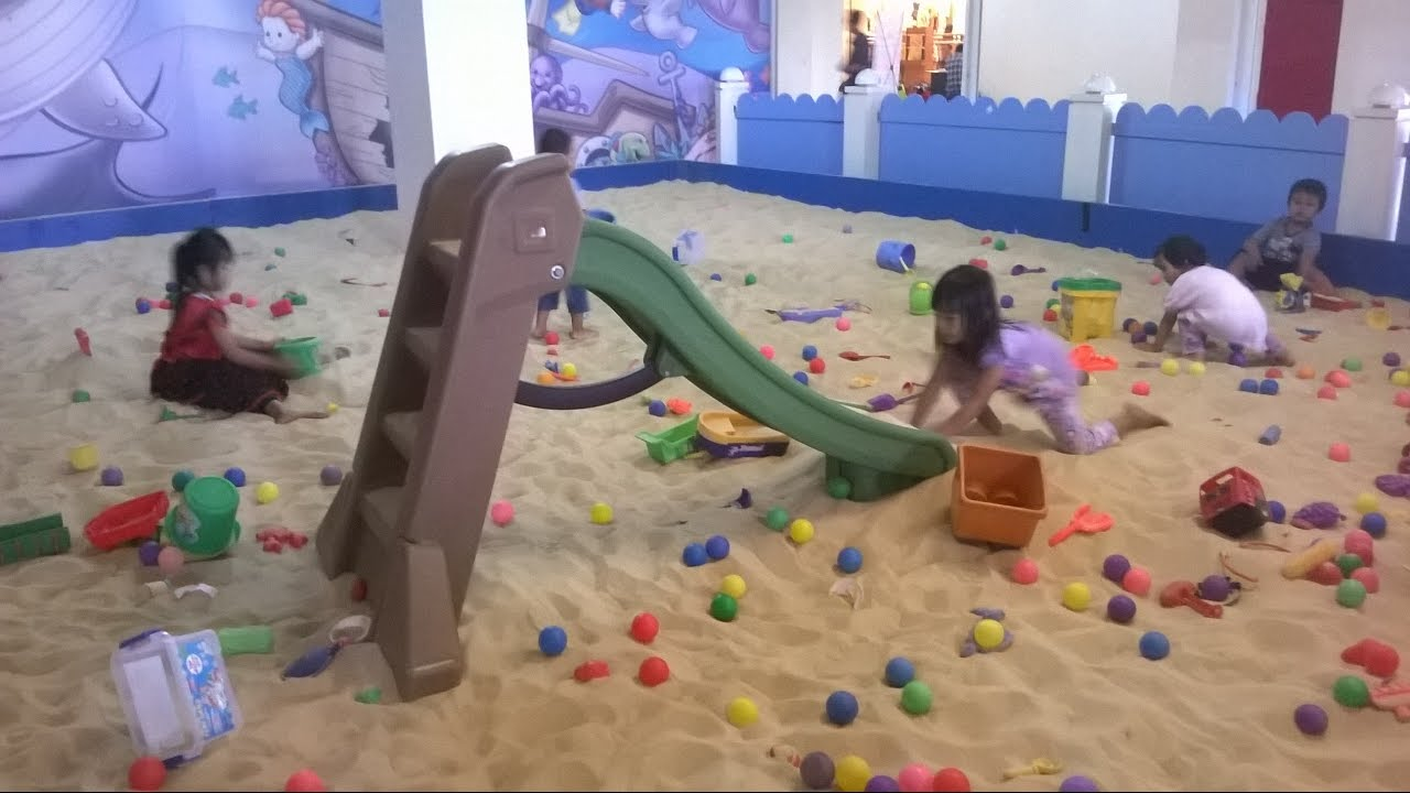 kids playing sand on the indoor playground play slide on. Black Bedroom Furniture Sets. Home Design Ideas