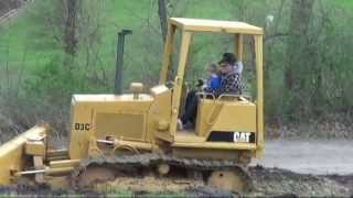 grandpap give tyler a lesson on operating a cat d3 dozer