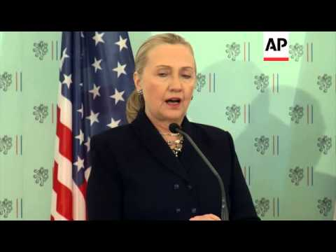 Clinton warns Syria on chemical weapons, pushes US bid for Czech nuclear project