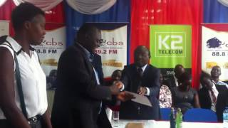 NUCAFE ED Joseph Nkandu receives the best Beverage Producer Award from the Katikiro