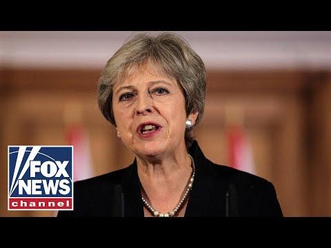 Theresa May survives