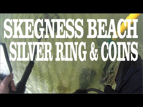 silver ring, and loads of coins metal detecting on skegness beach