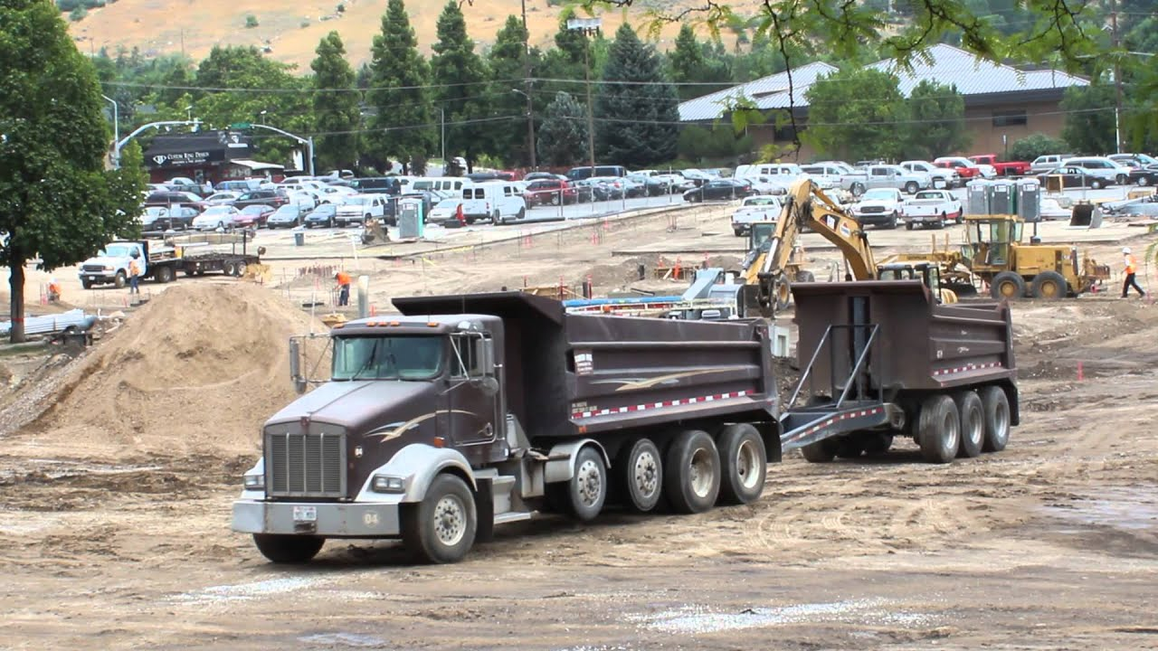 double dump truck and loader with forklift attachment