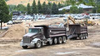 Double Dump Truck and loader with forklift attachment working