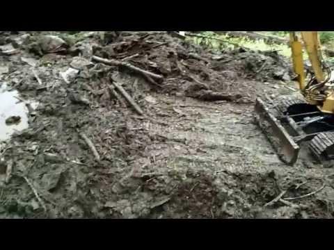 Clearing mud slide on Woodpecker Cove Road