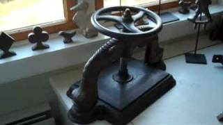 Antique Figural Cast Iron Book Binding Press with Demo(It still works!! Watch me demo it. Antique Figural Cast Iron Book Binding Press from the 1850s See more cool stuff like this on my blog: ..., 2009-11-07T20:10:30.000Z)
