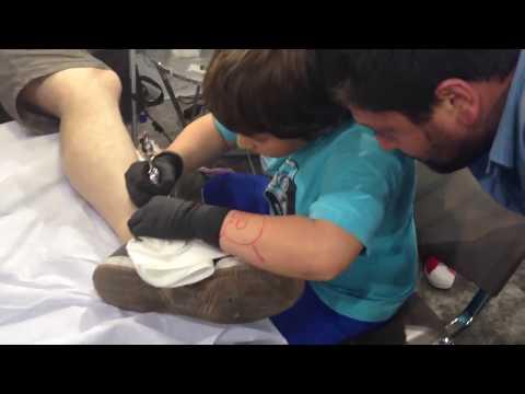 Niko Tsan (8 y.o.) doing his 2nd tattoo