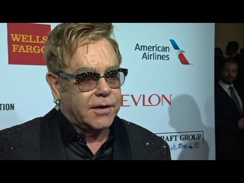 """Elton John tells gay community to """"wise up"""" over AIDS"""