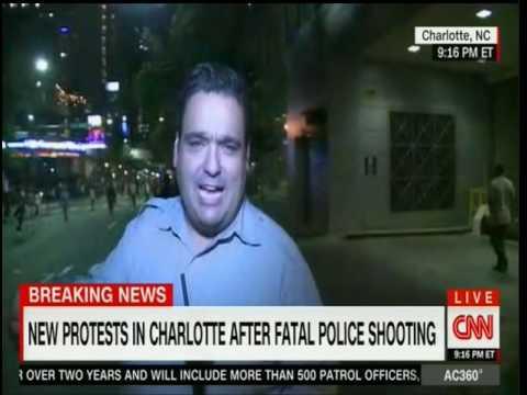 CNN's Ed Lavandera gets knocked down in Charlotte N.C.