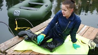 Jeans girl in waders and neon rain coat