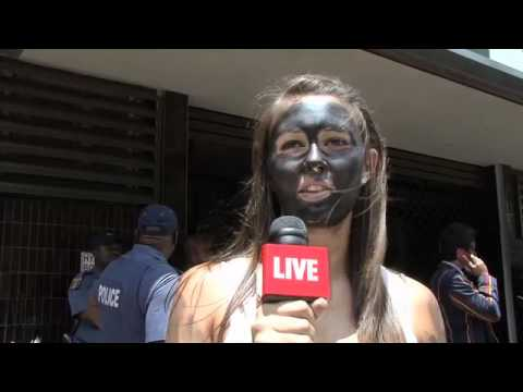 Students paint themselves black in protest - YouTube