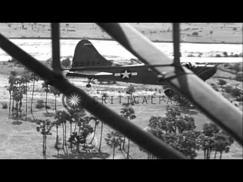 First Air Commando Stinson L-5 plane performs an aerial message pickup in Central...HD Stock Footage