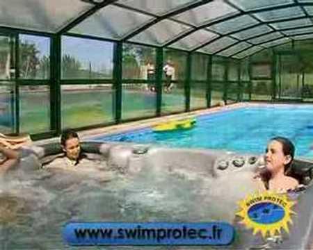 Abri de piscine swim protec youtube for Prix abri piscine haut telescopique