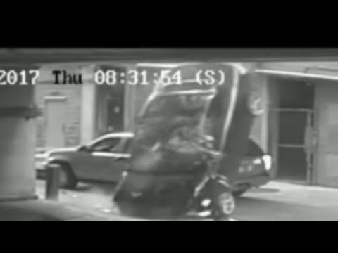 Watch A Woman Drive Her BMW Off A 7 Story Parking Garage.. She's In Critical Condition..