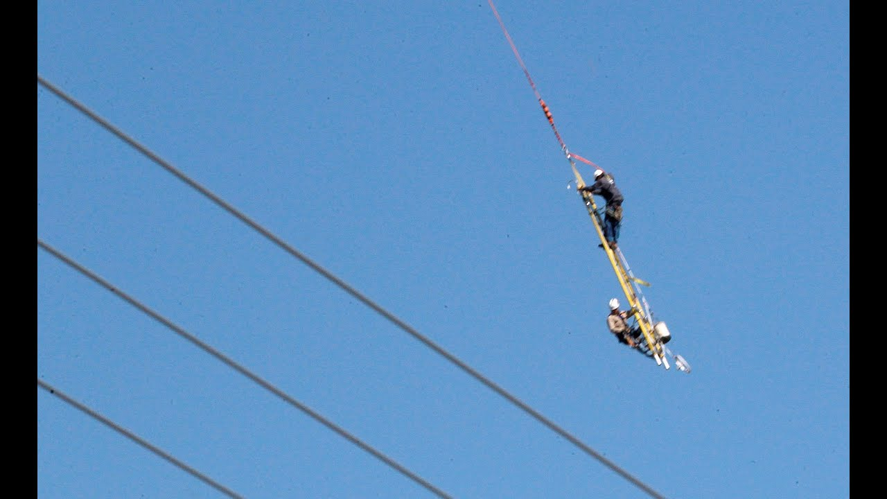 Crazy Helicopter Ride For Linemen Hanging From Ladder