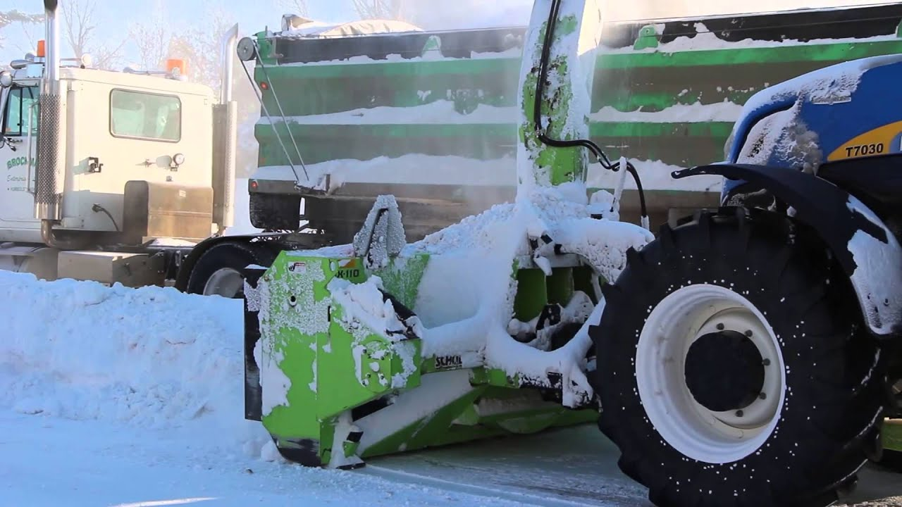 Snow Thrower Truck : Schulte snow blower loading trucks from streets in