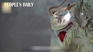 Folk artists created a dancing dragon that breathes smoke with more than 600 fish skins