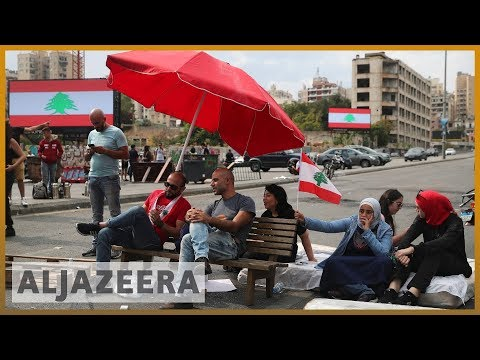 Lebanese protesters set up barricades, block main roads
