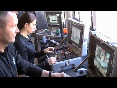 Robots Examine Vehicle | QinetiQ North America