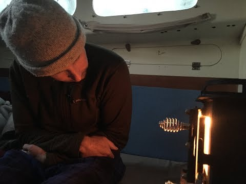 DIY Sailing: Cubic Mini Cub wood stove aboard a small sailboat.