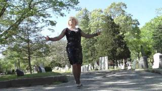 drag queen walks through grave yard
