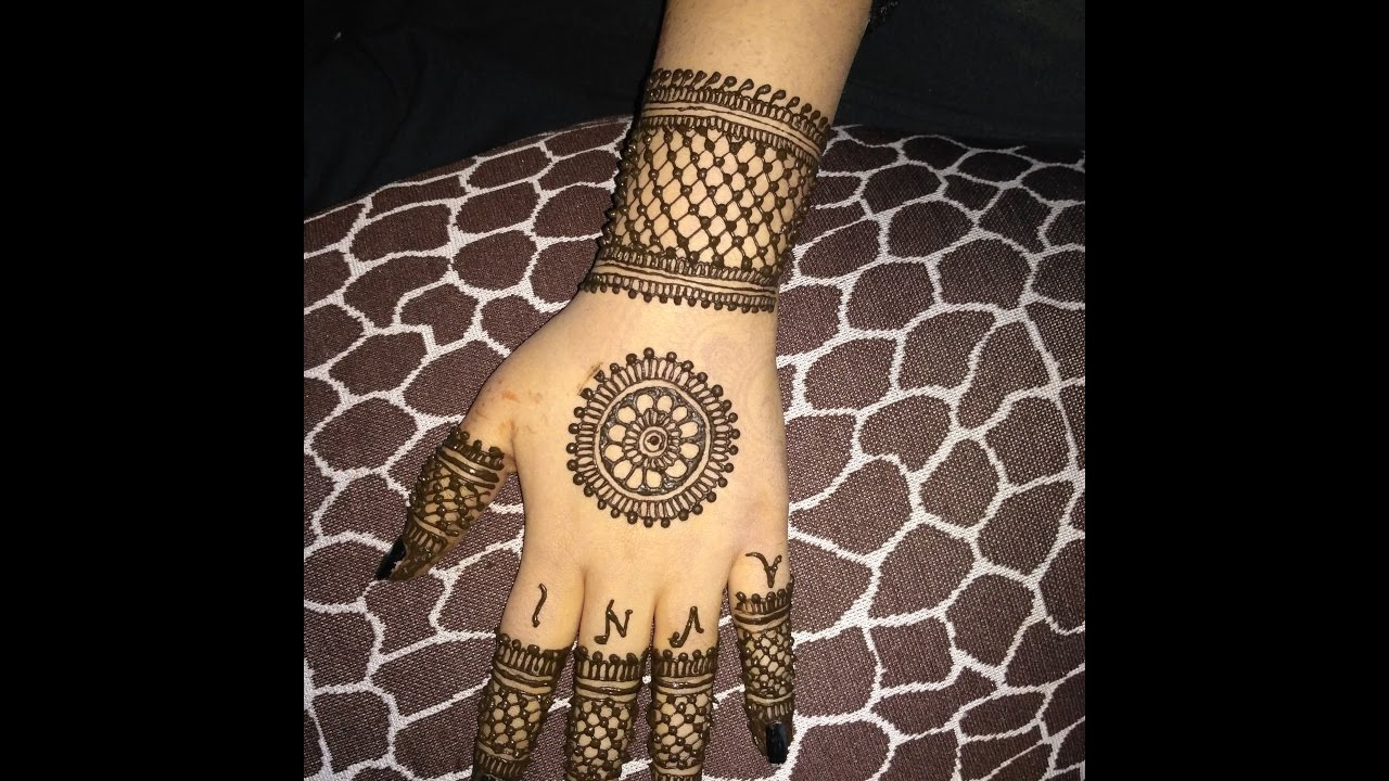 simple back hand round mehndi design
