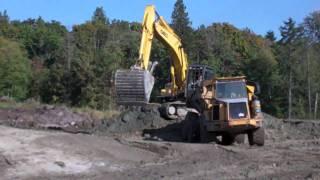 Excavator, Dump Truck & Bulldozer-Construction Equipment at Work